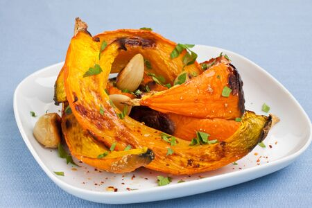 Oven roasted pumpkin slices on plate
