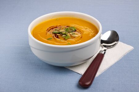 Bowl with pumpkin soup Stock Photo