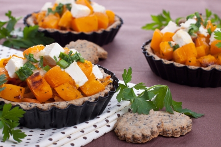 Cheese and pumpkin pies on brown background