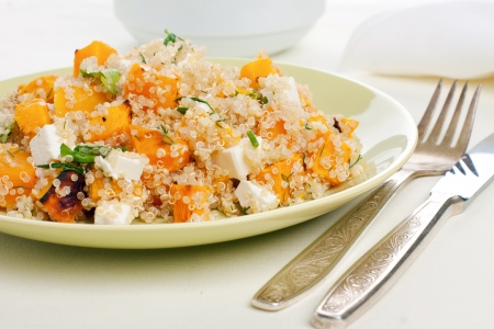 Plate of quinoa salad with feta and pumpkin Stock Photo
