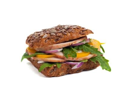 Wholegrain sanwich with seeds, vegetables and chicken, isolated