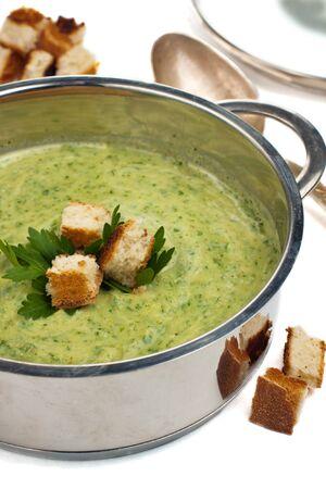 Saucepan with pureed broccoli soup and spoon Stock Photo - 15964132