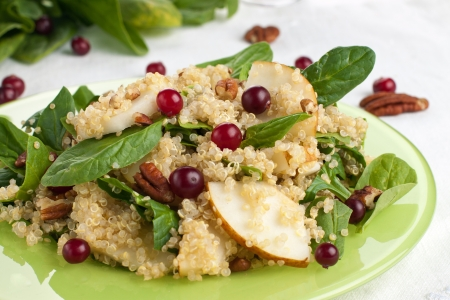 Quinoa pear salad with spinach, cranberries and pecan Stock Photo