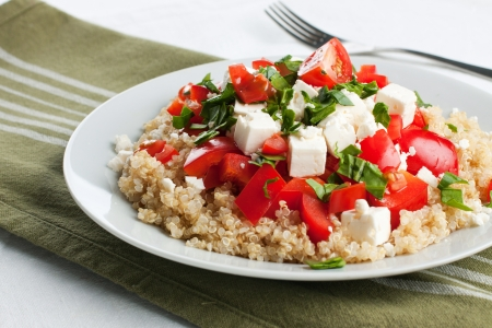 Portion of healthy vegetarian quinoa tomato salad Stock Photo