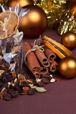 Cinnamon sticks and variety of other spices with dried lemon slices and christmas decoration