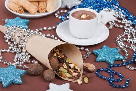 Christmas composition with spices and coffee and silver garland on background