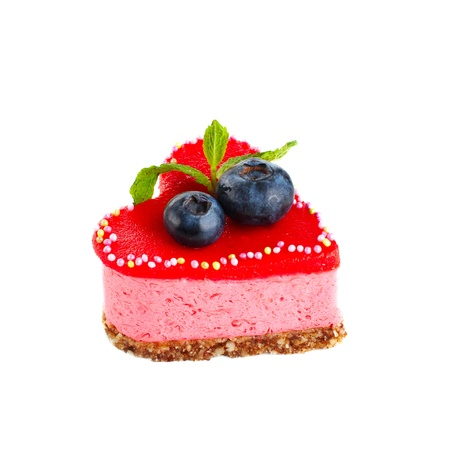 Small heart shaped sponge cake decorated with berries
