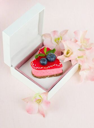 White box with cake inside and some flowers Stock Photo - 16730085
