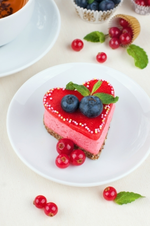 Valentine day cake decorated with red marzipan and berries Stock Photo - 16730087