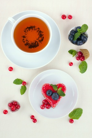 Heart cake with cup of tea and berries Stock Photo - 16730089