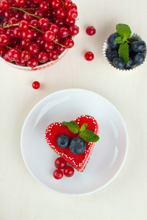 Valentine cake decorated with berries on plate