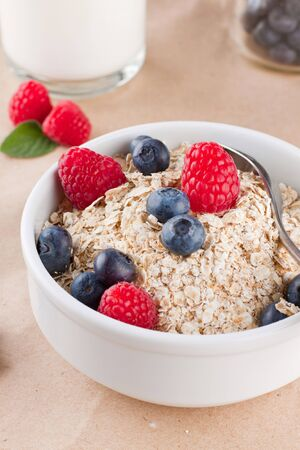Bowl full of cereals with berries