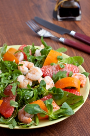 Plate full of salad with shrimps and grapefruit Stock Photo