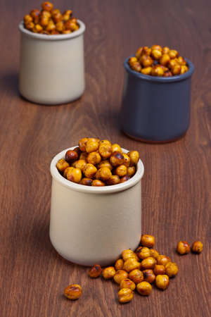 Roasted spicy chickpea in ceramic jars
