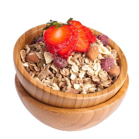 Healthy fruit and nut muesli with fresh strawberry on top photo