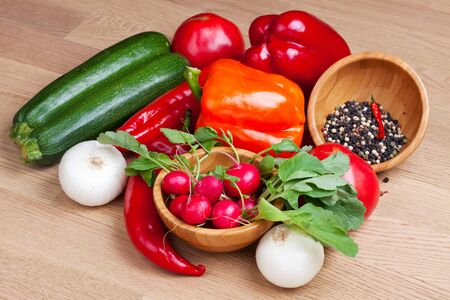 Group of fresh colorful vegetabes on wooden background Stock Photo