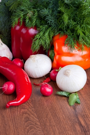 A selection of fresh ripe vegetables on wooden background Stock Photo