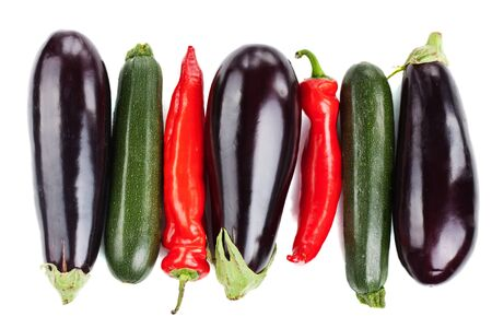 Colorful fresh vegetables arranged in a row on white background Stock Photo
