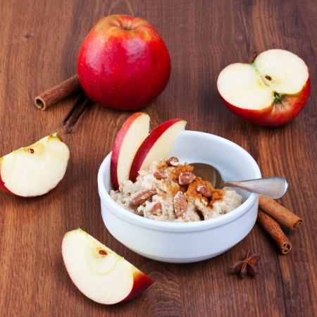 Bowl of oatmeal with apples and cinnamon