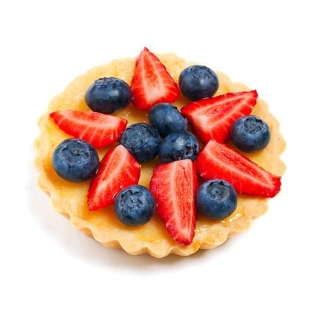 Tartlet with fresh berries isolated over white photo