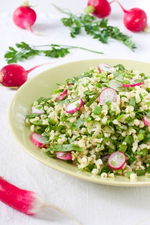 Plate of salad with bulgur, vegetables and herbs Stock Photo