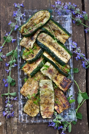 Plate of grilled zucchini garnished with fresh thyme shot from above Stock Photo