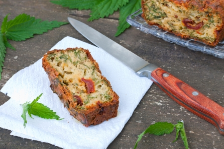 Piece of cake with green herbs and tomatoes, shallow depth of field