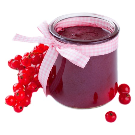 Glass jar of a red currant jam over white Stock Photo