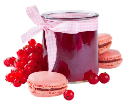 Glass jar of red currant jam with fresh berries and pink macaroon over white Stock Photo - 22999255