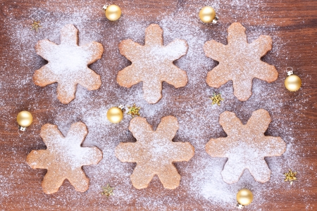 Snowflake shaped cookies with small golden baubles Stock Photo - 22999276