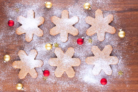 Gingerbread cookies decorated with powdered sugar and small christmas baubles Stock Photo - 22999277