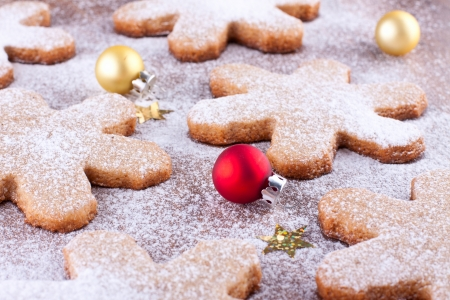 Small christmas baubles and gingerbread cookies Stock Photo - 22999278