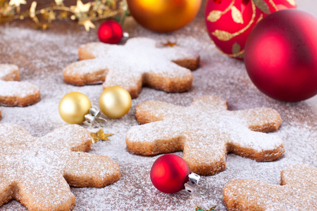 Snowflake shaped cookies and bright christmas decoration Stock Photo - 22999279