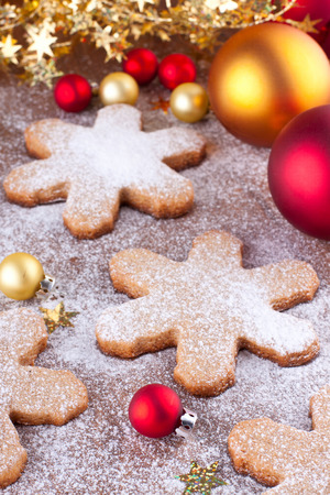 Gingerbread cookies with red and golden christmas decorations Stock Photo - 22999280