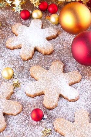 Christmas composition with bright baubles and gigerbread cookies Stock Photo - 22999282