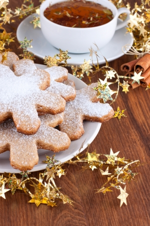 Plate of cookies and a cup of herbal tea with Christmas decoration Stock Photo - 22999296