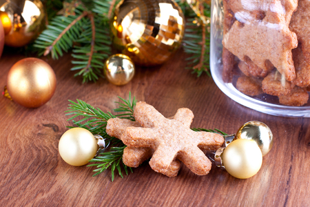 Christmas composition with golden baubles and snowflake shaped cookies Stock Photo - 23211700