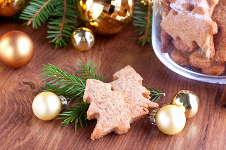 Gingerbread cookies with pine branches and golden baubles Stock Photo - 23211701