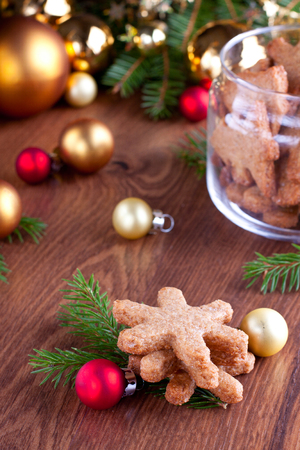 Snowflake shaped cookies with bright red and golden christmas decorations on background Stock Photo - 23211703