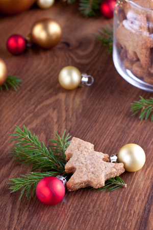 Close up of a cookie shaped as a fir tree with christmas baubles Stock Photo - 23211704