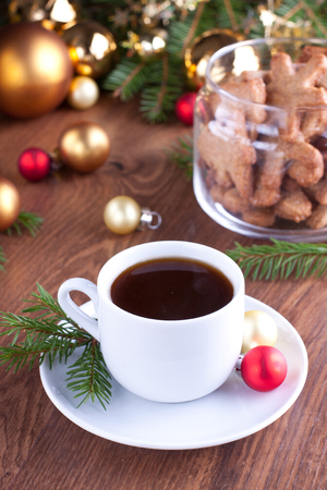 Cup of coffee with baubles and gingerbread cookies on background Stock Photo - 23853920