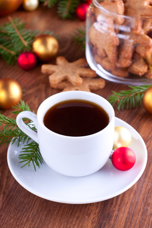 Christmas composition with coffee, cookies and colorful baubles photo