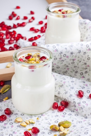 Yogurt with nuts and pomegranate seeds  Stock Photo