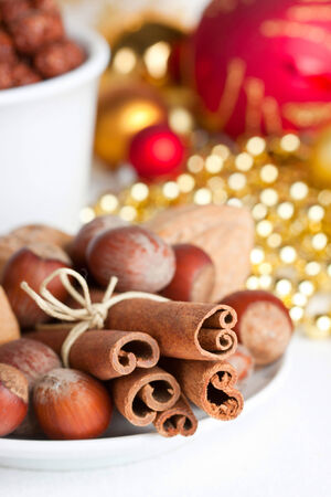 Christmas composition with nuts and cinnamon, shallow depth of field photo