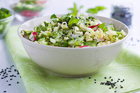 Bowl full of salad with millet