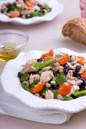 Close up of tuna and bean salad with fresh tomatoes Stock Photo