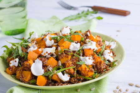 Healthy pumpkin salad with grains and cheese Stock Photo