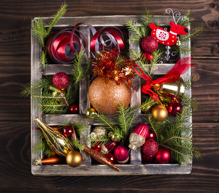 Wooden box with assorted Christmas decorations Stock Photo