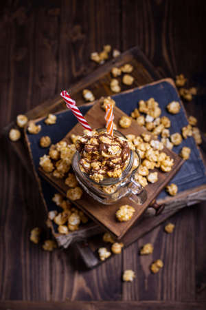 Sweet caramel popcorn covered with chocolate Stock Photo