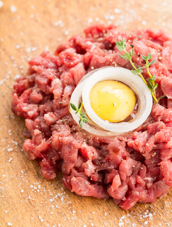 Close up of a raw beef tartare with a quail yolk in its centre